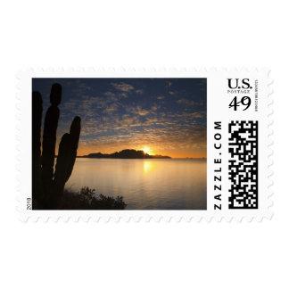 The sunrise over Isla Danzante in the Gulf of Postage