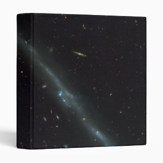 The Tadpole Galaxy- Distorted Victim of Cosmic 3 Ring Binders