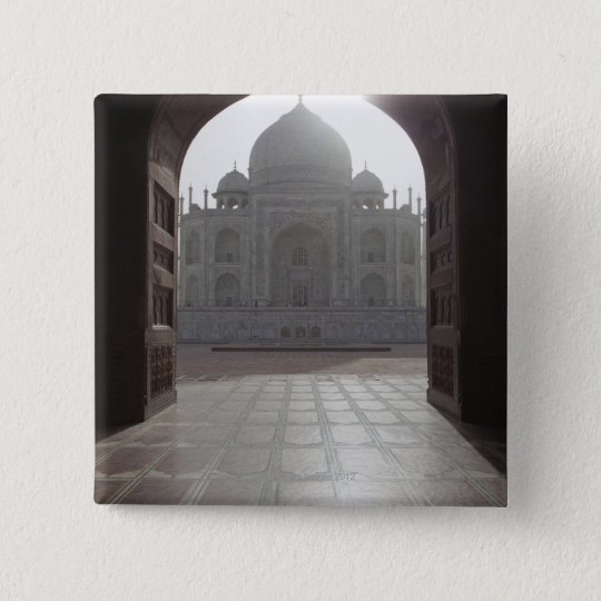 The Taj Mahal framed through the doorway to the Button