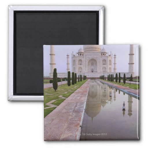 The Taj Mahal perfectly reflected in the still Fridge Magnets