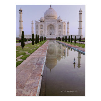 The Taj Mahal perfectly reflected in the still Postcards