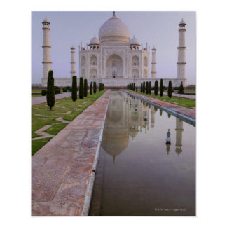 The Taj Mahal perfectly reflected in the still Poster