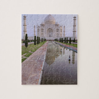 The Taj Mahal perfectly reflected in the still Puzzles