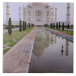 The Taj Mahal perfectly reflected in the still Ceramic Tiles