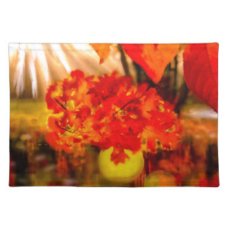 The tennis ball is adorned for Fall. Placemat