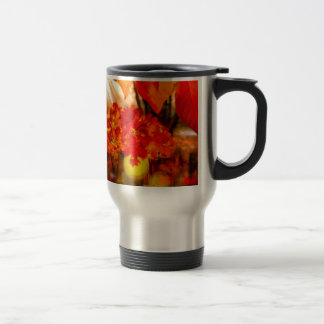 The tennis ball is adorned for Fall. Travel Mug