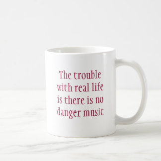 The trouble with real life is there is no dange... coffee mug