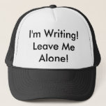 "The Trucker Hat: &quot;I&#39;m Writing! Leave Me Alone!&quot; Trucker Hat<br><div class=""desc"">Your family should get the message now! Wear this when you&#39;re stealing away for a few minutes. If they still don&#39;t get the hint,  take it off and whack them with it.</div>"