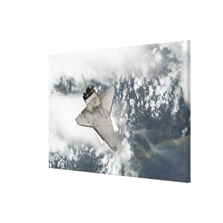 The underside of space shuttle Discovery Canvas Print