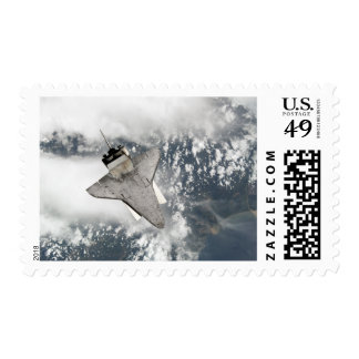 The underside of space shuttle Discovery Postage