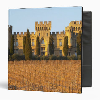 The vineyard with syrah vines and the chateau 3 ring binder