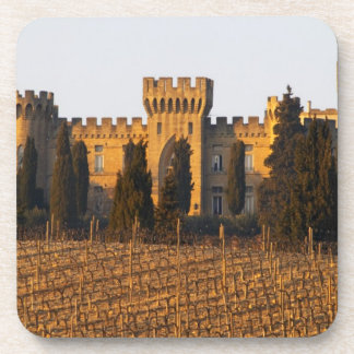 The vineyard with syrah vines and the chateau beverage coaster