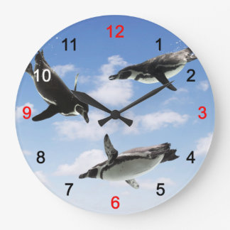The wall clock of the penguin which flies through