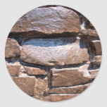 The wall of the large natural stone, painted brown classic round sticker