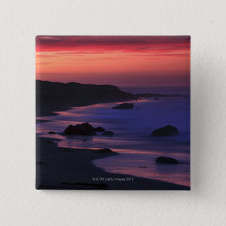The warm hues of dawn reflect along the pinback button