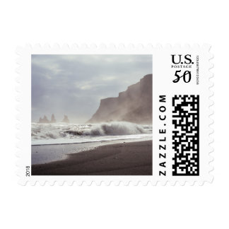 The waves break on the beach postage