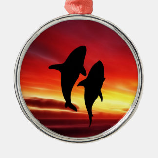 The whales dance at sunset metal ornament