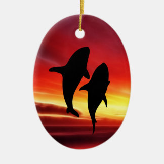 The whales dance at sunset Double-Sided oval ceramic christmas ornament