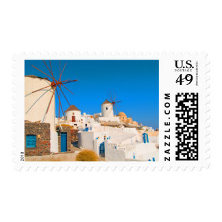 The white buildings and the windmills on the postage