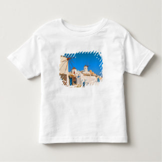 The white buildings and the windmills on the toddler t-shirt