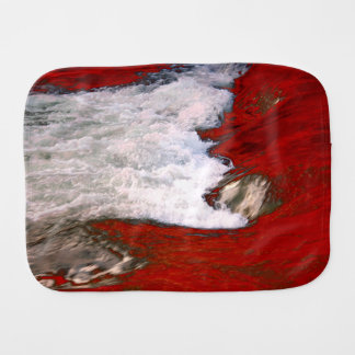The white foam stops to the red lava river baby burp cloth