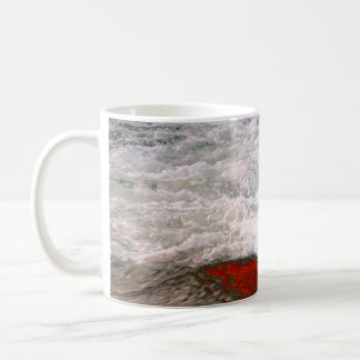 The white foam stops to the red lava river coffee mug