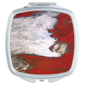 The white foam stops to the red lava river compact mirrors