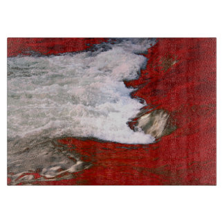 The white foam stops to the red lava river cutting boards
