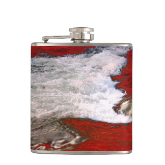 The white foam stops to the red lava river hip flasks