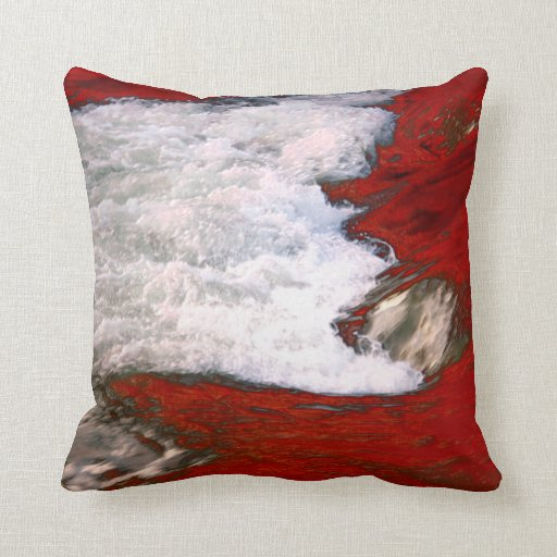 The white foam stops to the red lava river throw pillow