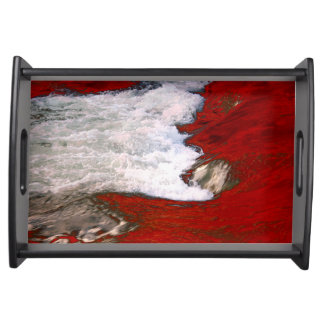 The white foam stops to the red lava river serving trays