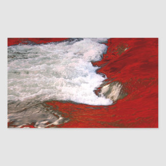The white foam stops to the red lava river