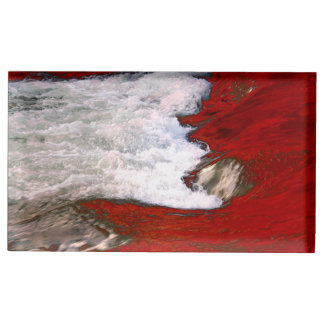 The white foam stops to the red lava river table card holder