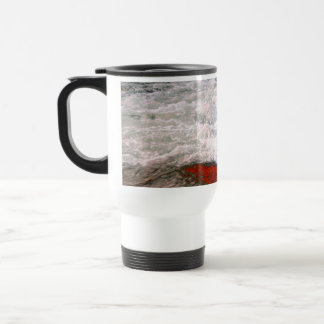The white foam stops to the red lava river travel mug