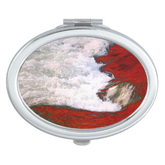 The white foam stops to the red lava river vanity mirror