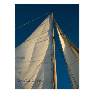 The wind is yours, old sails over the blue sky postcard