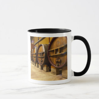 The wine cellar winery with big old wooden casks mug