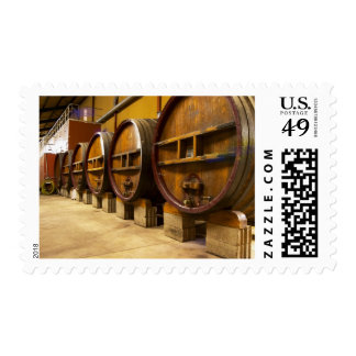 The wine cellar winery with big old wooden casks postage