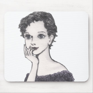 The woman rests her cheek on her hand mouse pad