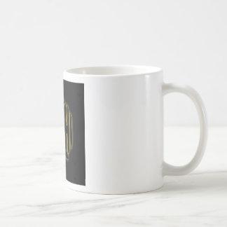The word Ahimsa glowing in the dark Coffee Mug