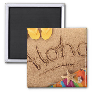 The word Aloha written on a sandy beach, with 2 2 Inch Square Magnet