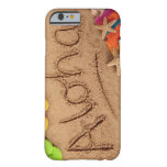 The word Aloha written on a sandy beach, with 2 Barely There iPhone 6 Case
