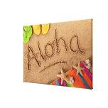 The word Aloha written on a sandy beach, with 2 Canvas Print