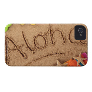 The word Aloha written on a sandy beach, with 2 iPhone 4 Cover