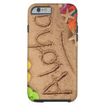 The word Aloha written on a sandy beach, with 2 Tough iPhone 6 Case