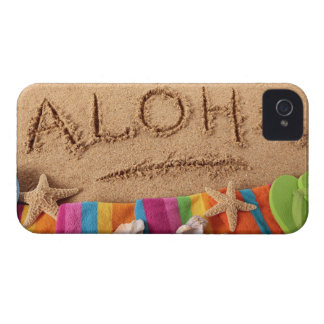 The word Aloha written on a sandy beach, with Case-Mate iPhone 4 Case