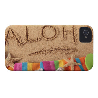 The word Aloha written on a sandy beach, with iPhone 4 Case