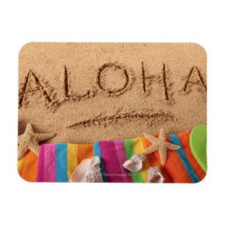 The word Aloha written on a sandy beach, with Rectangular Photo Magnet