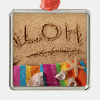 The word Aloha written on a sandy beach, with Square Metal Christmas Ornament