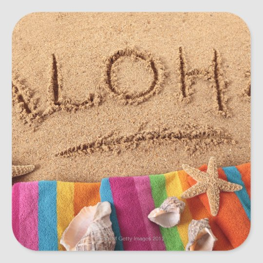 The word Aloha written on a sandy beach, with Square Sticker